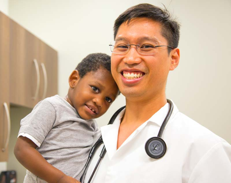 Doctor holding a child.
